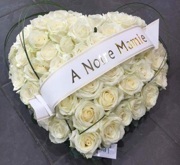 white heart shaped funeral bouquet